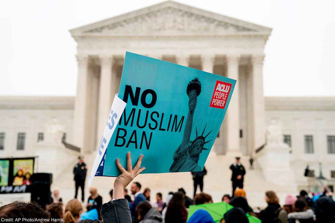 """A person holds up a sign that reads """"No Muslim Ban"""" during an anti-Muslim ban rally at the Supreme Court."""