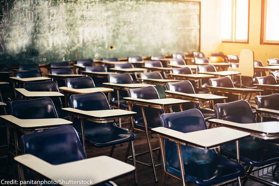 selective soft and blur focus.old wooden row lecture chairs in classroom in poor school.study room without student.