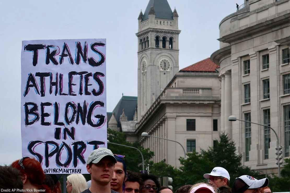 """Image of a protest sign that reads """"Trans athletes belong in sports"""""""